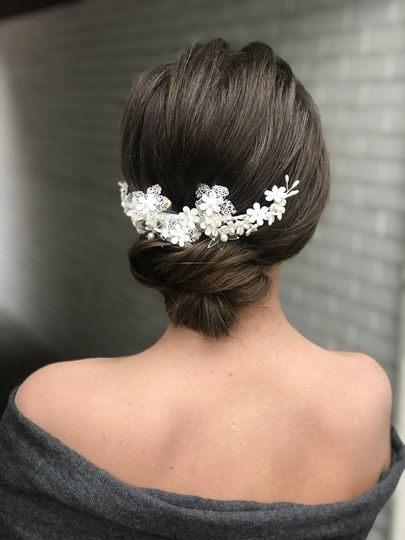 Updo with hairpiece