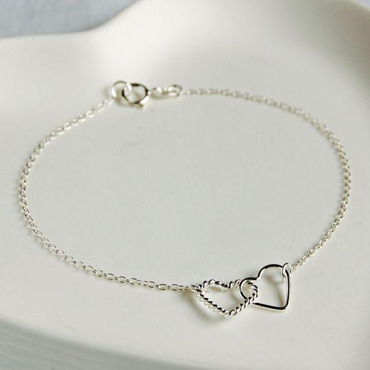 Silver linked hearts bracelet