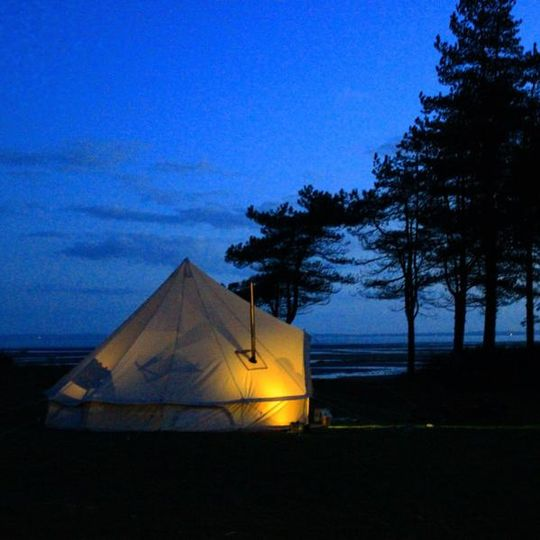 Bell tent with woodburner