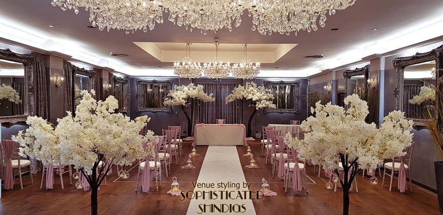 crown hotel bawtry ceremony aisle view blush drapes ivory canopy blossom trees diamante wraps wm 4 110865 161903403384351