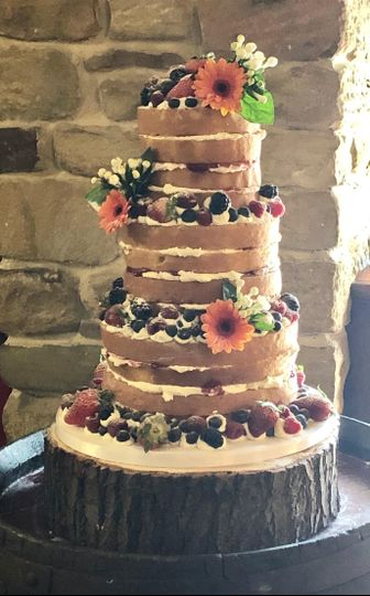 Daisy-fruit-loaded naked cake