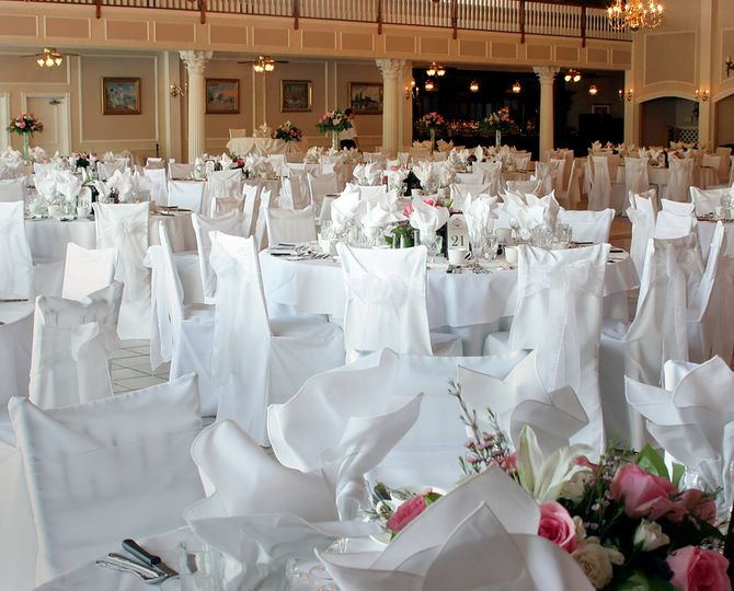 White chair covers with white sash