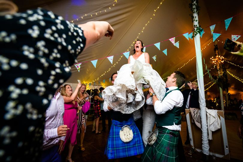 Bride hoisted up on a chair