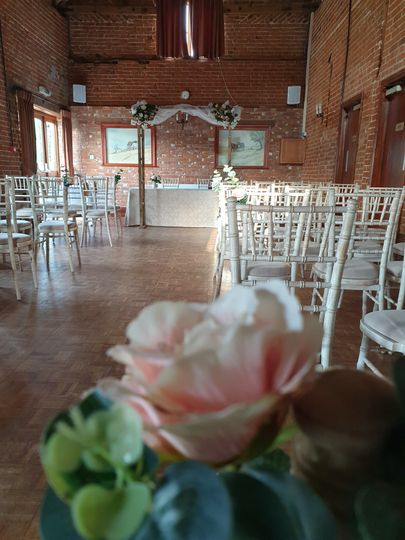 Ceremony chairs and floral arrangements