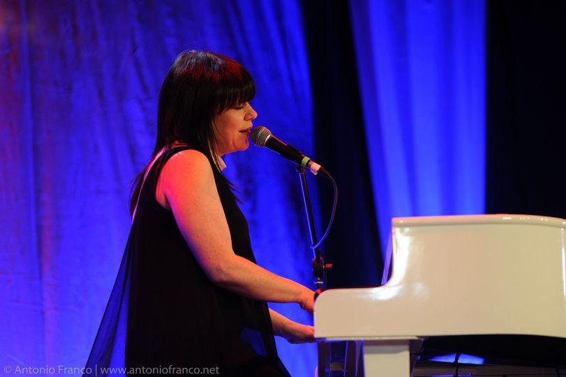 Victoria on white grand piano