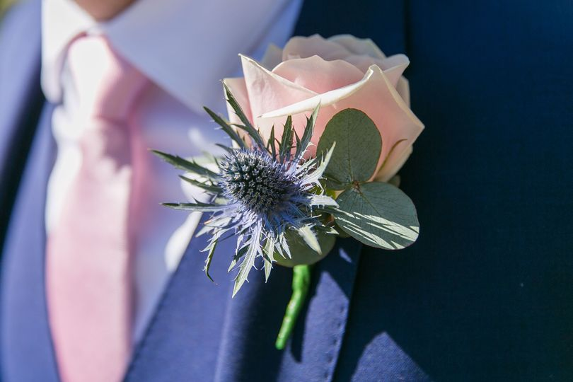 Sweet Avalanche Rose and Eryngium Buttonhole with Eucalyptus