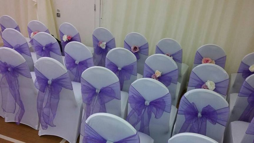 Chair covers, sash and flower