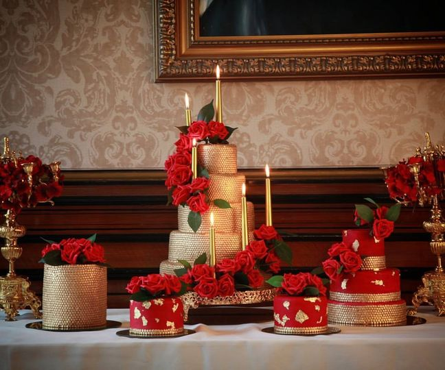 Cascading red cake florals