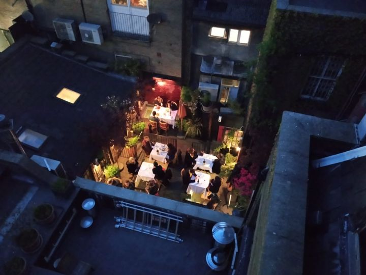 Roof terrace by night.