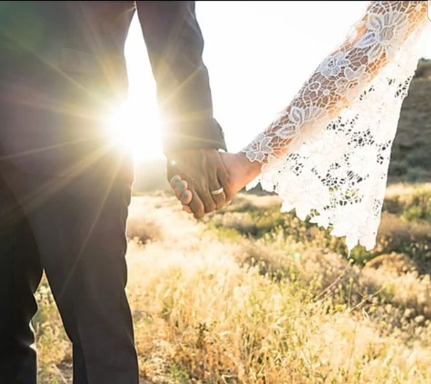 Holding hands - Hat & Feather Photography