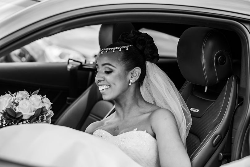 Bride in the wedding car - Natalie Chiverton Photography