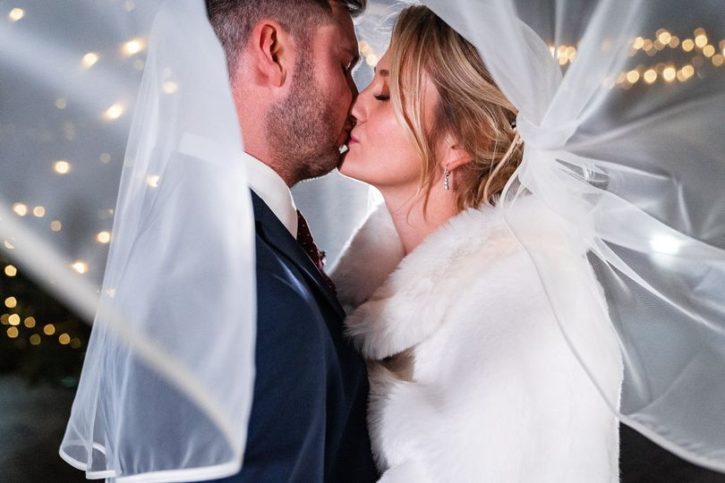 Kissing under the veil - Natalie Chiverton Photography