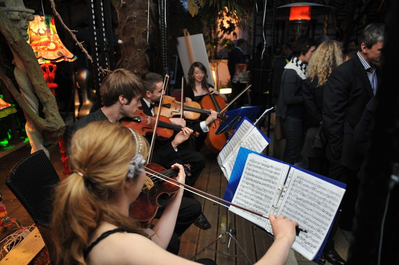 One of our quartets playing in Kensington Roof Garden, a lovely venue.