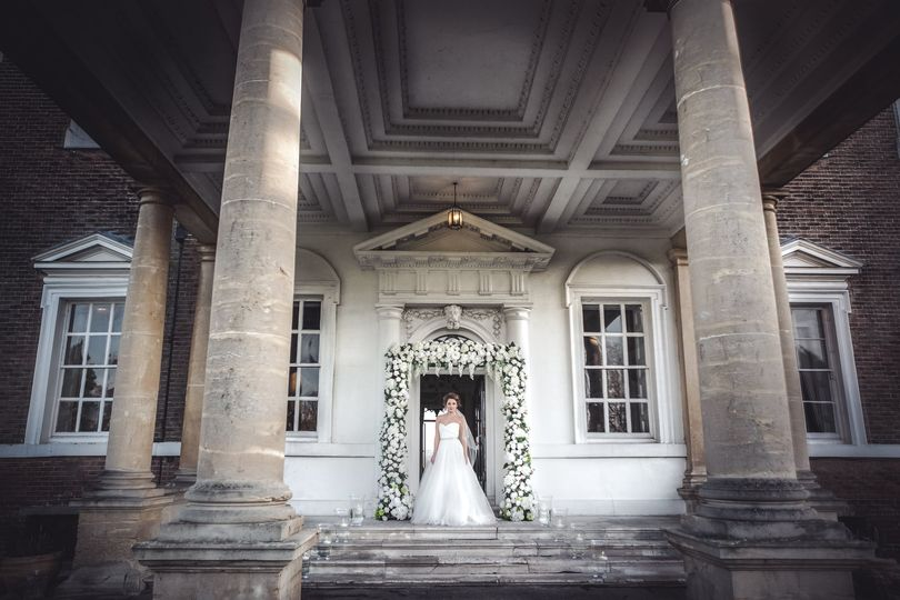 Bride at The House Entrance