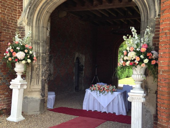 Pedestal and urn flowers