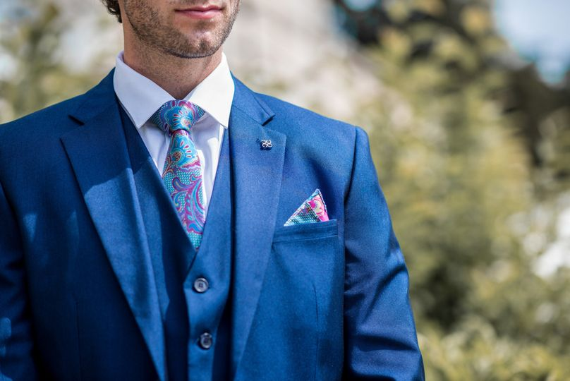 Blue suit with colourful tie
