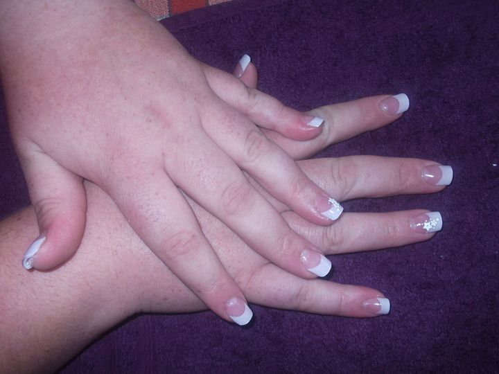 Acrylic nail extensions with white tips and nail art