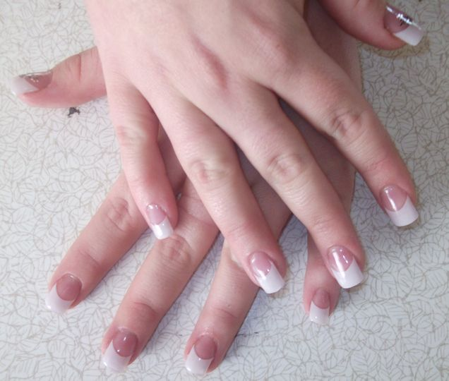 Acrylic nail extensions with white tips