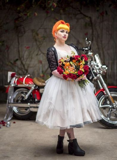 Bride standing in front of a motorbike