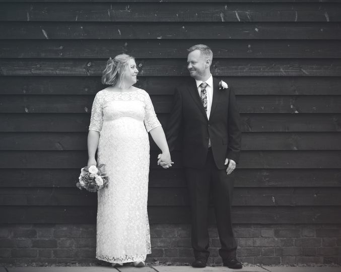 Couple smiling and holding hands