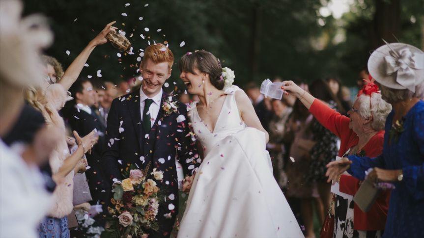 Showered in confetti - Andy Stelmach Wedding Filmmaker