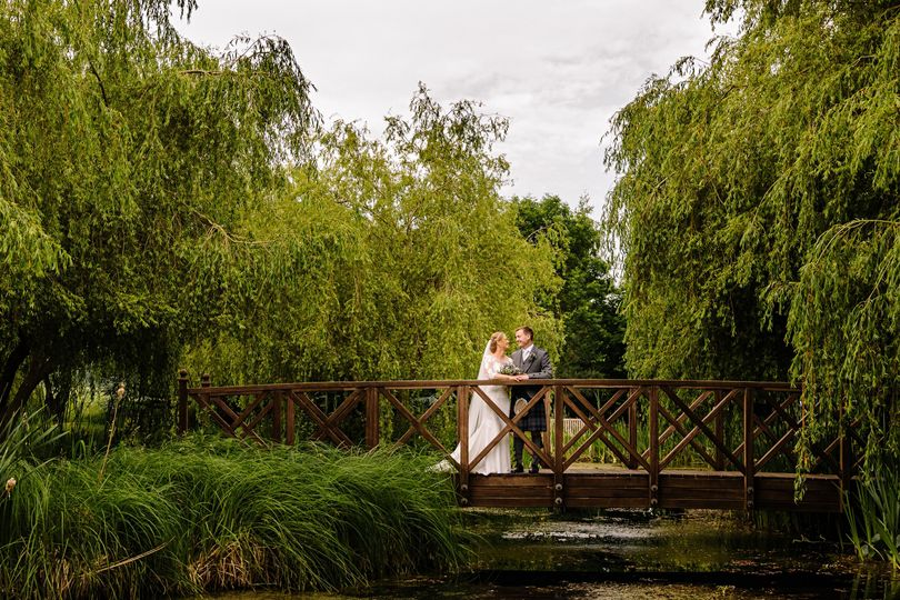 Newlyweds on a bridge - SMH Photography