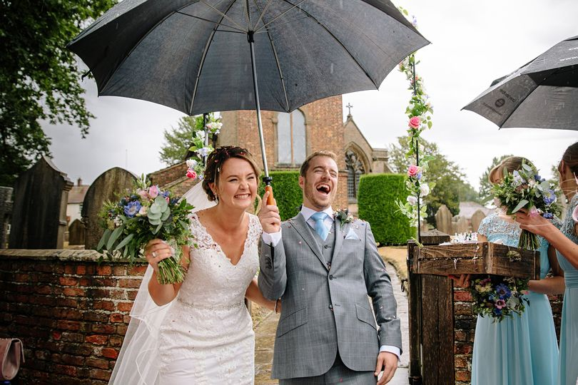 Laughing under an umbrella - SMH Photography