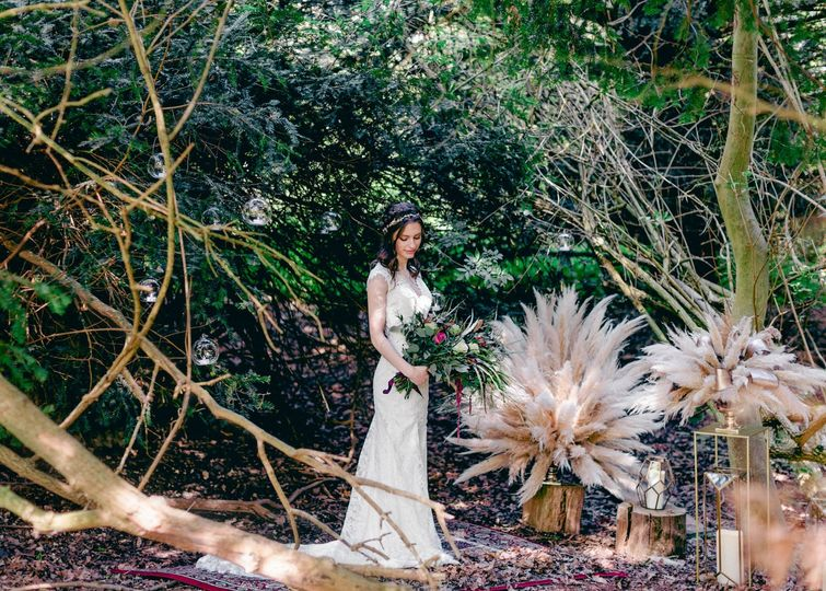 Bride standing among the trees