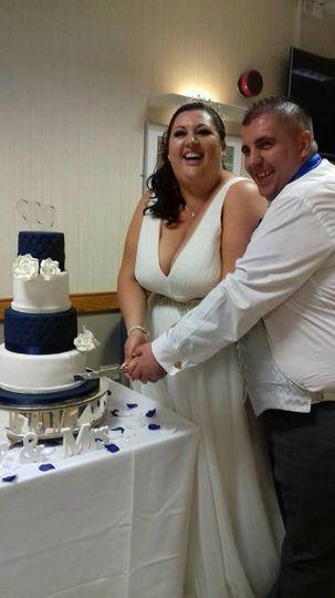 Couple celebrating cake cut