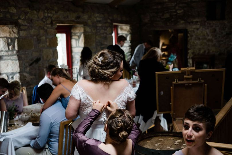 Re-fastening the brides dress