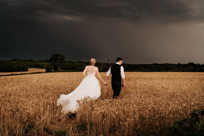 Holding hands in a field - Samantha Pells Photography