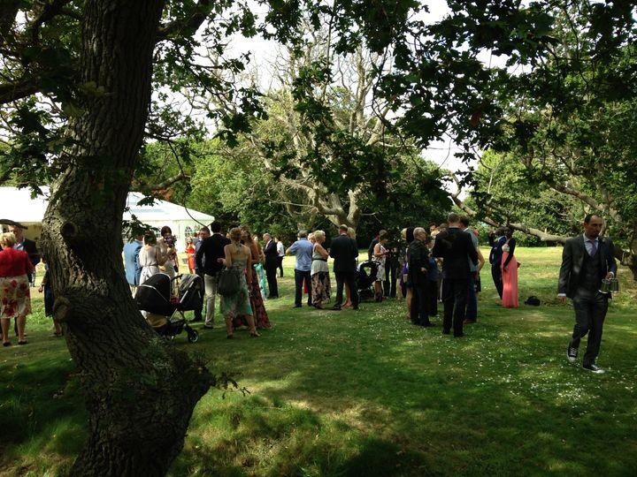 Happy wedding guests at Tournerbury