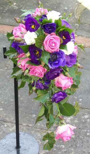 Purple wedding flowers and lilac roses