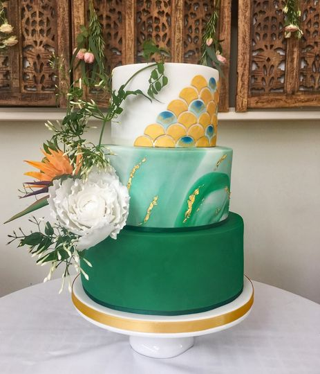 Green and gold peacock cake