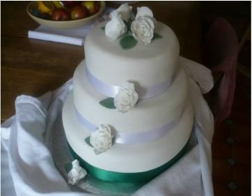 White cake with green base
