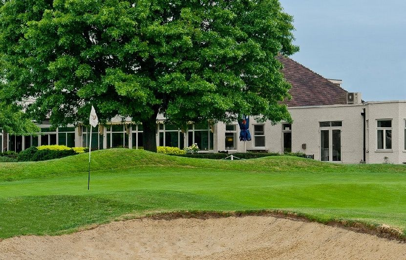 The eighth green by the clubhouse