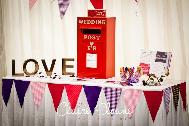 Red post box at a wedding