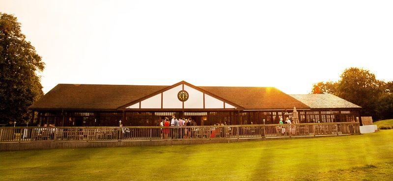 The sun setting behind the club