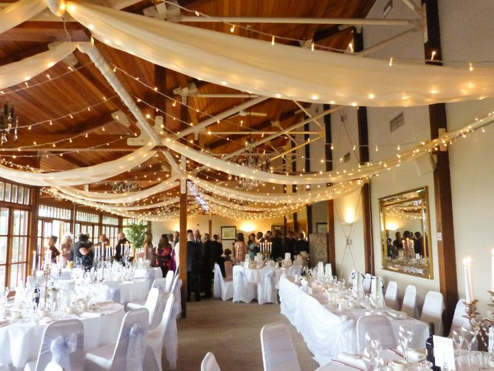 The room dressed with Swags & Lights (external co. used)
