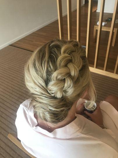 Low bun with Dutch braid