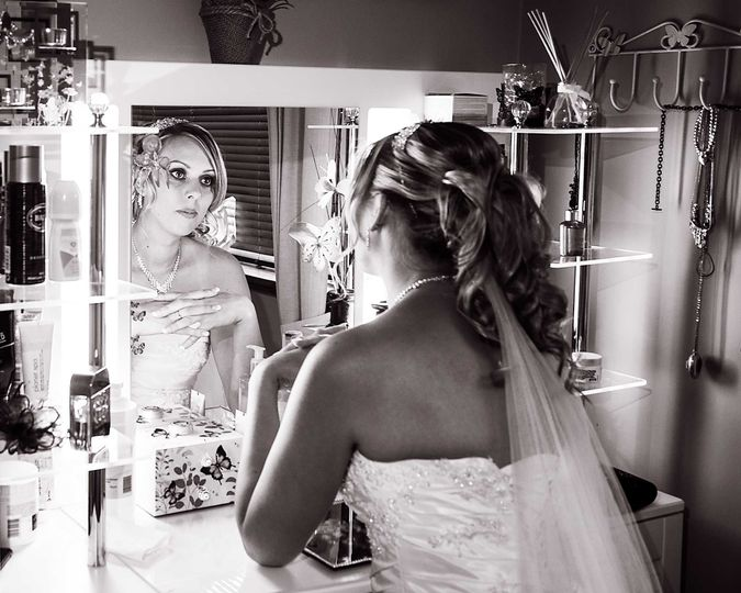 Bride at home in the mirror