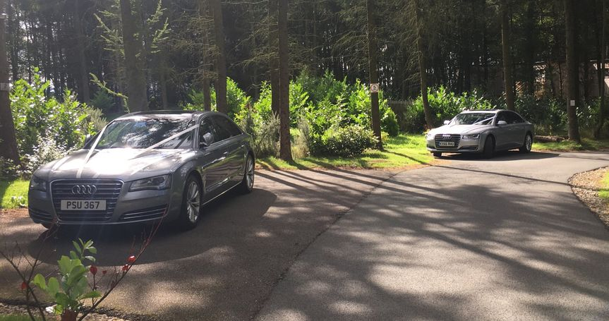 Two silver Audi's