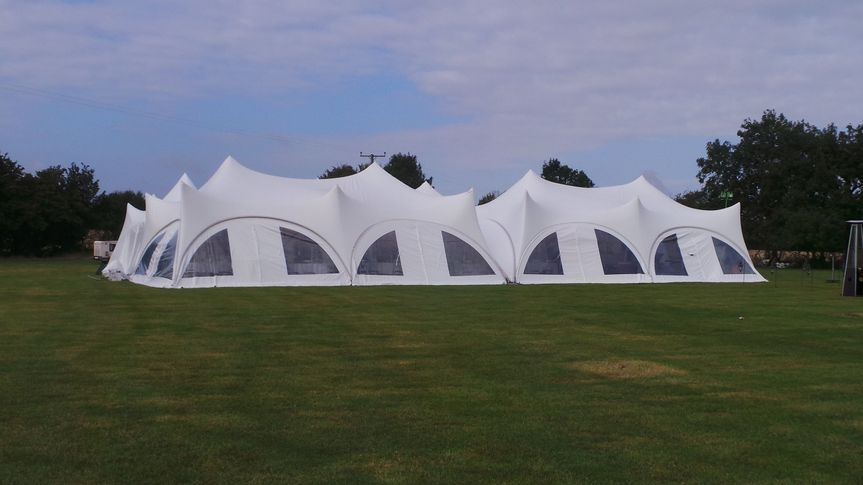 Adjoined trapeze marquees