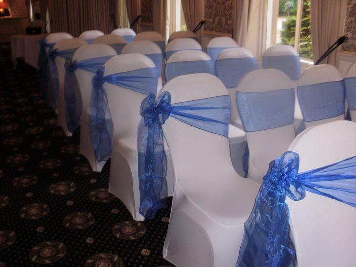 White covers/royal blue sash