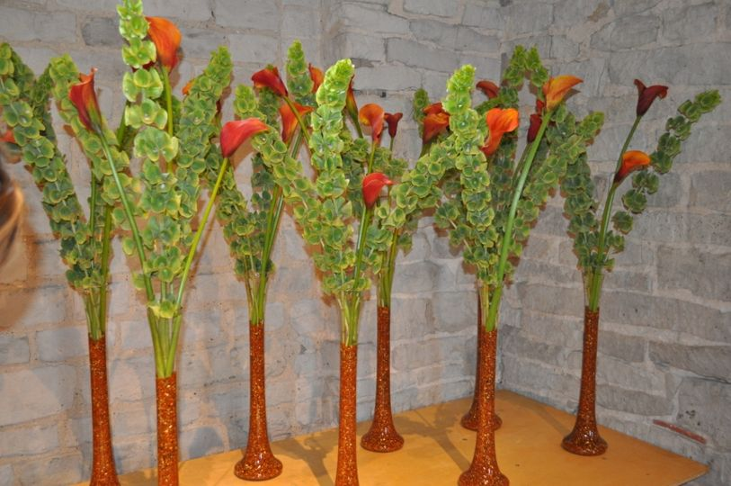 Calla Lily and Mollucella table displays