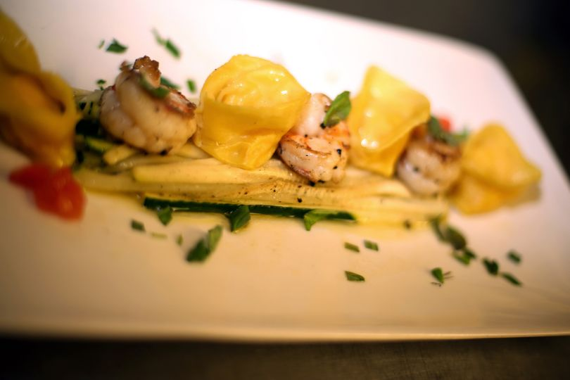 King Prawns and Ravioli on a bed of Courgette