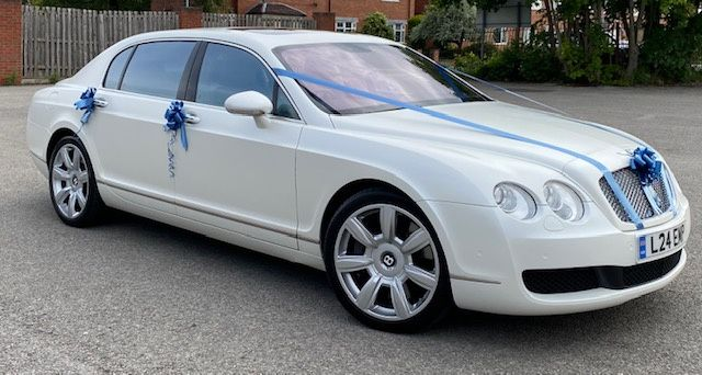 Bentley with blue ribbon