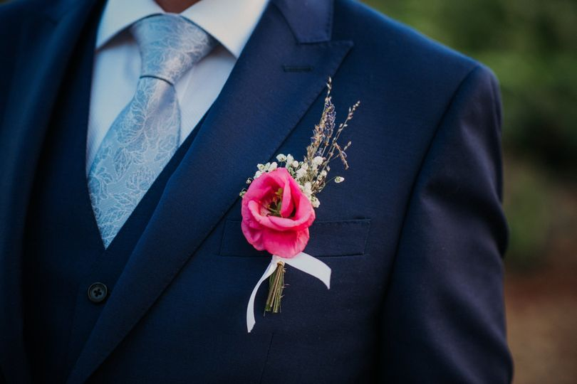 Pink flower and blue suit