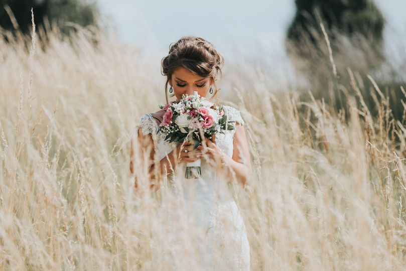 Bride in a field - Tom Jeavons Photography