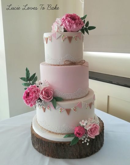 Bunting, lace and floral cake